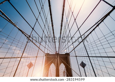 Brooklyn Bridge, New York City. Flare filtered image. - stock photo