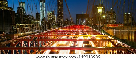 Brooklyn Bridge panorama with traffic at dusk, New York City - stock photo
