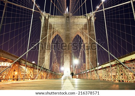 Brooklyn Bridge pedestrian walkway at night - stock photo