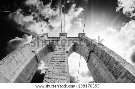 Brooklyn Bridge Pillar and Cable Pattern with dramatic Sky, Manhattan - New York City