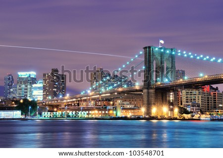 Brooklyn Bridge spanning the East River towards Brooklyn in New York City. - stock photo
