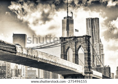 Brooklyn Bridge surrounded by Manhattan skyscrapers. - stock photo