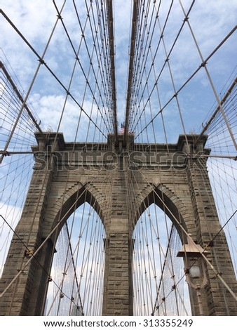Brooklyn Bridge up close with an upward angle.
