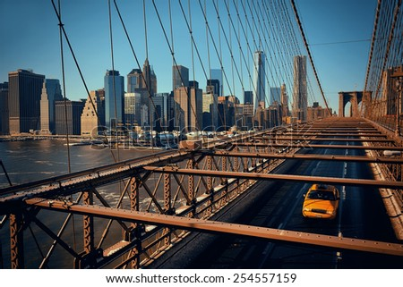 Brooklyn Bridge view Manhattan with yellow cab and skyscrapers. - stock photo