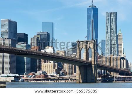 Brooklyn Bridge with lower Manhattan skyline in New York City - stock photo