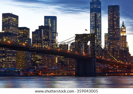 Brooklyn Bridge with lower Manhattan skyline in New York City at evening - stock photo