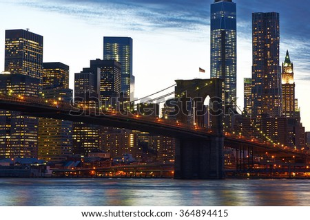 Brooklyn Bridge with lower Manhattan skyline in New York City at evening