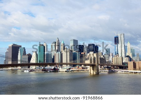 Brooklyn Bridge with lower Manhattan skyline in the morning over East River in New York City