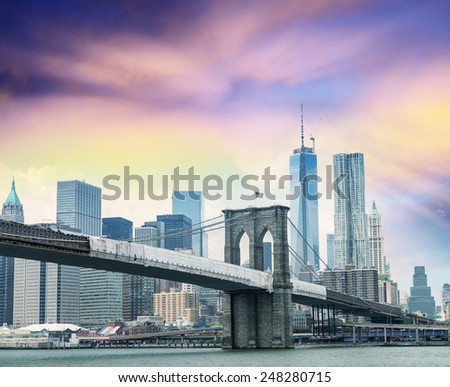 Brooklyn Bridge with Manhattan on background. - stock photo