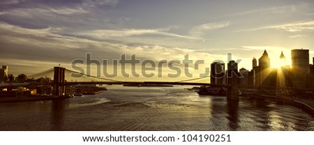 Brooklyn Bridge with sunset over Manhattan - stock photo