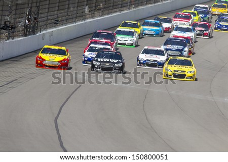 BROOKLYN, MI - AUG 18, 2013:  The NASCAR Sprint Cup teams take to the track for the Pure Michigan 400 race at the Michigan International Speedway in Brooklyn,  MI on Aug 18, 2013. - stock photo