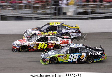 BROOKLYN, MI - JUNE 13:   Carl Edwards, Greg Biffle and David Reutimann take it three wide during the Heluva Good 400 race at the Michigan International Speedway in Brooklyn, MI on June 13, 2010 - stock photo