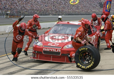 BROOKLYN, MI - JUNE 13: Juan Pablo Montoya comes in for a pit stop during the Heluva Good! Sour Cream Dips 400 race at the Michigan International Speedway on June 13, 2010 in Brooklyn, MI. - stock photo