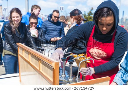 BROOKLYN, NEW YORK CITY - APR 4, 2015: Opening day for foodies at Smorgasburg in Williamsburg, Brooklyn, NYC.  Smorgasburg is a spring and summer outdoor mecca for food lovers and food vendors in NYC. - stock photo