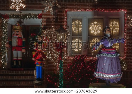 BROOKLYN, NEW YORK - DECEMBER 14: Dazzling spectacle of Christmas holiday decorations in the neighborhood of Dyker Heights on December 14, 2014 in Brooklyn, New York, USA - stock photo