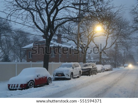 BROOKLYN, NEW YORK - JANUARY 7, 2017: Snowfall continues in Brooklyn, NY after massive Winter Storm Helena strikes Northeast.