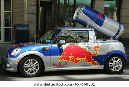 BROOKLYN, NEW YORK - JULY 19, 2016:  A Red Bull mini cooper publicity car with a can of Red Bull drink in Brooklyn