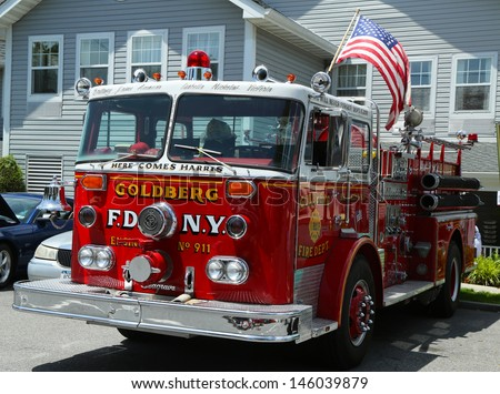 BROOKLYN, NEW YORK - JULY 14:Fire truck on display at the Mill Basin car show held on July 14, 2013 in Brooklyn, New York  - stock photo