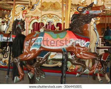 BROOKLYN, NEW YORK - JUNE 7, 2015: Horses on a traditional fairground B&B carousel at historic Coney Island Boardwalk in Brooklyn - stock photo