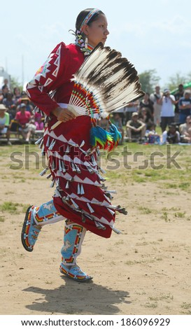 BROOKLYN, NEW YORK -JUNE 2:Unidentified female Native American dancer at the NYC Pow Wow in Brooklyn on June 2, 2013. A pow-wow is a gathering and Heritage Celebration of North America s Native people - stock photo