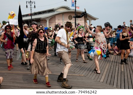 BROOKLYN, NEW YORK - JUNE 18: Unidentified participants of the 28th annual Coney Island Mermaid Parade on June 18, 2011 at Coney Island, Brooklyn, NY, USA.