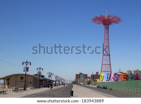 BROOKLYN, NEW YORK - MARCH 18  Coney Island Boardwalk with Parachute Jump in the background on March 18, 2014 at Coney Island, NY  The boardwalk, built in 1923, stretches for 2 51 miles - stock photo