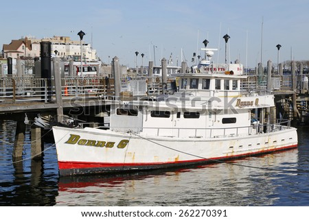 BROOKLYN, NEW YORK - MARCH 19, 2015: Fishing boat charter on Sheeprshead Bay Marina in Brooklyn