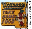 BROOKLYN, NEW YORK - MARCH 9 : The Nathan's original restaurant sign on March 9, 2013 at Coney Island, New York. The original Nathan's still exists on the same site that it did in 1916. - stock photo