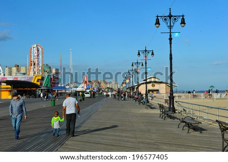 BROOKLYN, NEW YORK - MAY 31: Coney Island Boardwalk restored after damage by Hurricane Sandy on May,31 2014 at Coney Island, NY. The boardwalk, built in 1923, stretches for 2.51 miles. - stock photo