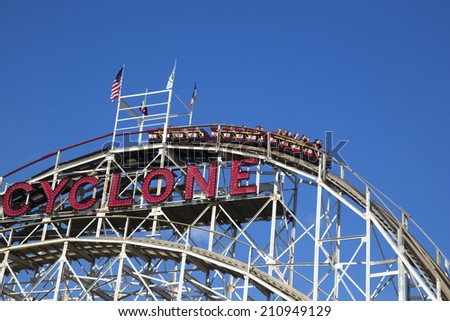 BROOKLYN, NEW YORK - MAY 17:Historical landmark Cyclone roller coaster on May 17, 2014 in the Coney Island section of Brooklyn. Cyclone is a historic wooden roller coaster opened on June 26, 1927