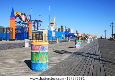 BROOKLYN, NEW YORK - OCTOBER 16: Coney Island Boardwalk before damage by Hurricane Sandy on October 16, 2012 at Coney Island, NY. The boardwalk, built in 1923, stretches for 2.51 miles.  - stock photo