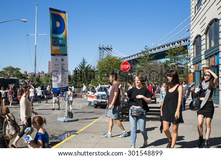 BROOKLYN, NEW YORK - SEPTEMBER 27, 2014:  Street view of the DUMBO Arts Festival in Brooklyn, New York City.  - stock photo