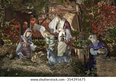BROOKLYN, NEW YORK, USA - DECEMBER 19: A Nativity scene in front of a Christmas decorated house in Dyker Heights between 11th and 12th avenue and 83rd street.  Taken December 19, 2015 in New York. - stock photo