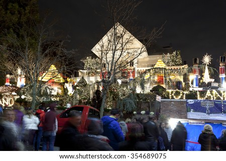 BROOKLYN, NEW YORK, USA - DECEMBER 19: People gather to see a house with Christmas lights  between 11th and 12th avenue and 83rd street in Dyker Heights. Taken December 19, 2015 in New York. - stock photo