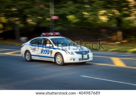 Brooklyn, New York, USA - 20th October 2012: NYPD car driving by Prospect park in Brooklyn, New York