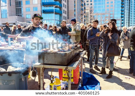 BROOKLYN, NY - APR 4, 2015: Opening day for foodies and vendors at Smorgasburg in Williamsburg, Brooklyn, NYC.  Smorgasburg is an outdoor market for food lovers. - stock photo