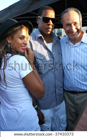 BROOKLYN, NY - AUGUST 30:  Jay-Z (C), Beyonce (L) and Chuck Schumer (R) attend the Jelly Pool Party held at East River Park on August 30, 2009 in Brooklyn, NY. - stock photo