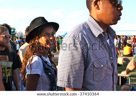 BROOKLYN, NY - AUGUST 30: Rapper Jay-Z (R) & Singer Beyonce (L) attend the Jelly Pool Party held at East River Park on August 30, 2009 in Brooklyn, NY. - stock photo