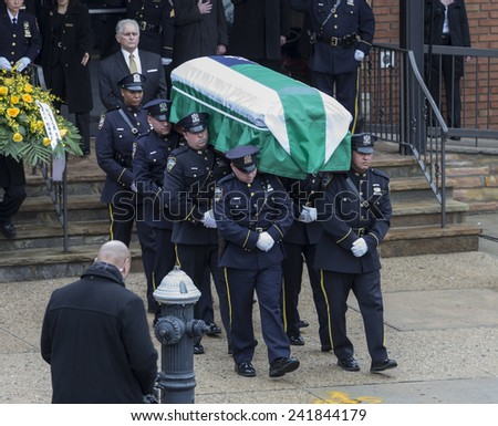 Brooklyn, NY - January 04, 2015: Police officers carry casket outside Aievoli Funeral Home for the funeral of slain New York City Police Officer Wenjian Liu