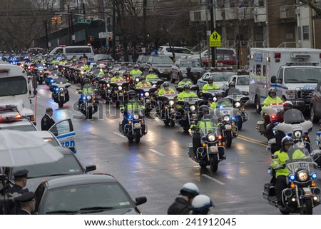 Brooklyn, NY - January 04, 2015: Police officers from around the country mourn outside Aievoli Funeral Home for the funeral of slain New York City Police Officer Wenjian Liu - stock photo