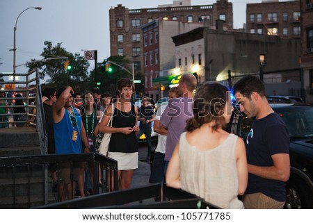 BROOKLYN, NY - JUNE 20:  Attendees outside of the Northside Festival screening of Ai WeiWei: Never Sorry, directed by Alison Klayman, presented by IFC at UnionDocs in Brooklyn, NY on June 20,2012 - stock photo