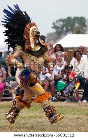 BROOKLYN, NY - JUNE 6: Aztec dancers performing on the Native American Festival at Floyd Bennett Field on June 6, 2010 in Brooklyn, NY. - stock photo