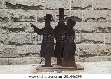 BROOKLYN, NY - JUNE 17: Statues of John Roebling, his son Washington and Washington's wife Emily who were chiefly responsible for the design and construction of the Brooklyn Bridge on June 17, 2014 - stock photo