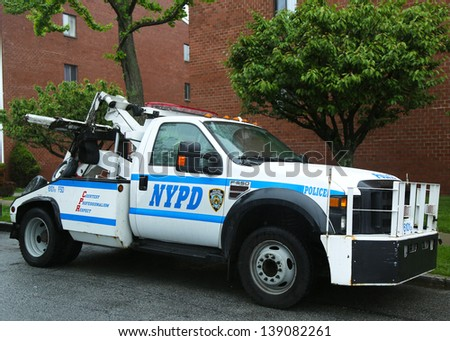 BROOKLYN, NY- MAY 19: NYPD tow truck in Brooklyn, NY on May 19, 2013. The New York Police Department, established in 1845, is the largest police force in USA - stock photo