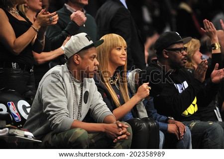 BROOKLYN, NY - November. 26. 2012: Beyonce and Jay-Z, who was the co-owner of  Brooklyn Nets, at court side of Brooklyn Nets vs New York Knicks game at Barclays Center  - stock photo