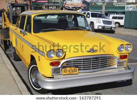 BROOKLYN, NY - NOVEMBER 19: Checker Taxi Cab produced by the Checker Motors Corporation in Brooklyn on November 19, 2013. The Checker remains the most famous taxi cab vehicle in the United States  - stock photo