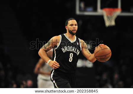 BROOKLYN, NY - November. 26. 2012: Deron Williams of  Brooklyn Nets, at the game of Brooklyn Nets vs New York Knicks, Barclays Center, Brooklyn, New York - stock photo