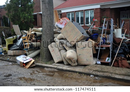 BROOKLYN, NY - NOVEMBER 01: Household items lay on the sidewalk after residents cleaned debris from the buildings at the Seagate neighborhood due to impact from Hurricane Sandy in Brooklyn, New York, U.S., on Thursday, November 01, 2012. - stock photo
