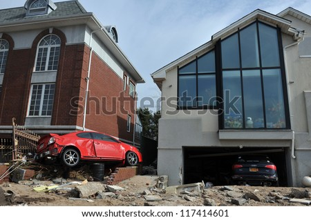 BROOKLYN, NY - NOVEMBER 01: Serious damage in the buildings and cars at the Seagate neighborhood due to impact from Hurricane Sandy in Brooklyn, New York, U.S., on Thursday, November 01, 2012. - stock photo