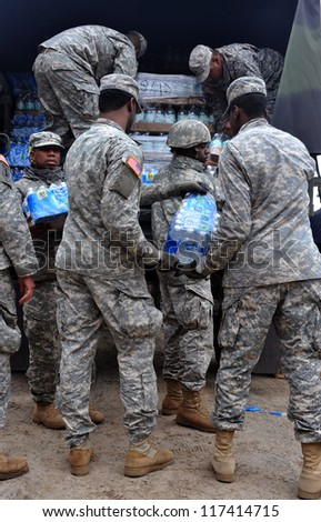 BROOKLYN, NY - NOVEMBER 01: US army helps peoples at the Seagate neighborhood wit Water and food due to impact from Hurricane Sandy in Brooklyn, New York, U.S., on Thursday, November 01, 2012. - stock photo